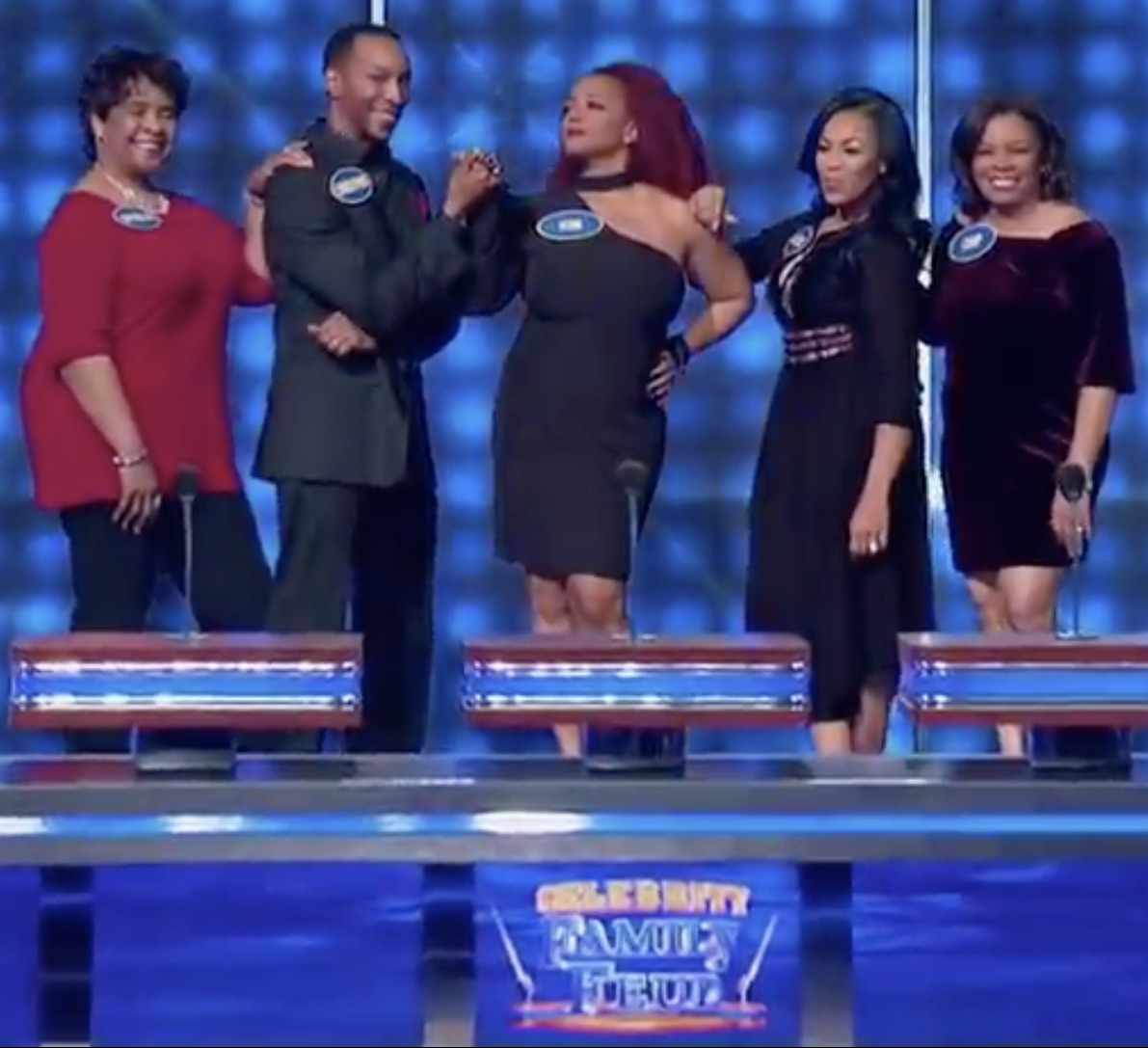 Kim Fields and family pose at the beginning of Celebrity Family Feud