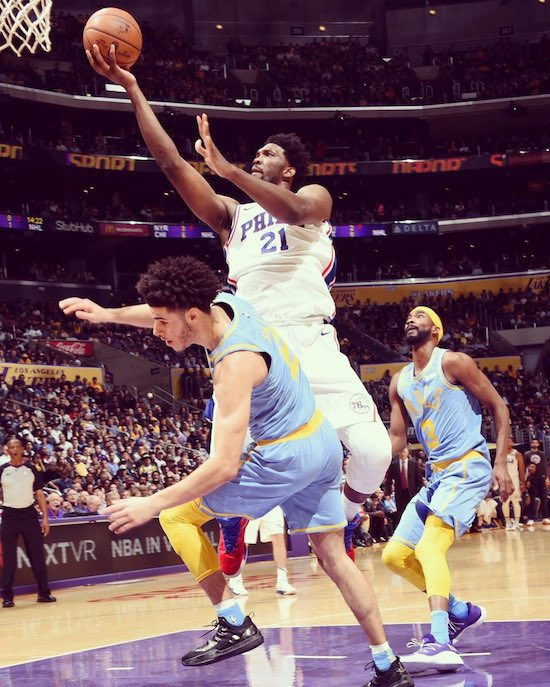 An overwhelming rush to the basket... (Philadelphia 76ers Joel Embiid vs. L.A. Lakers rookie Lonzo Ball)